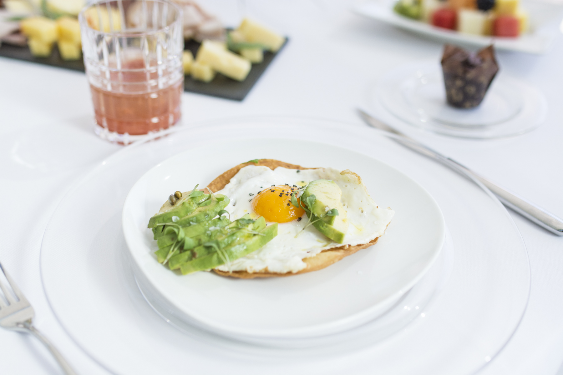 Corn tortilla with fried egg and avocado